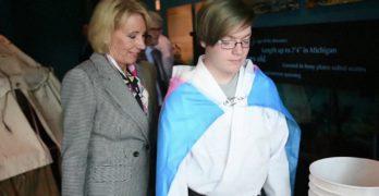Student meets Betsy DeVos wearing transgender flag